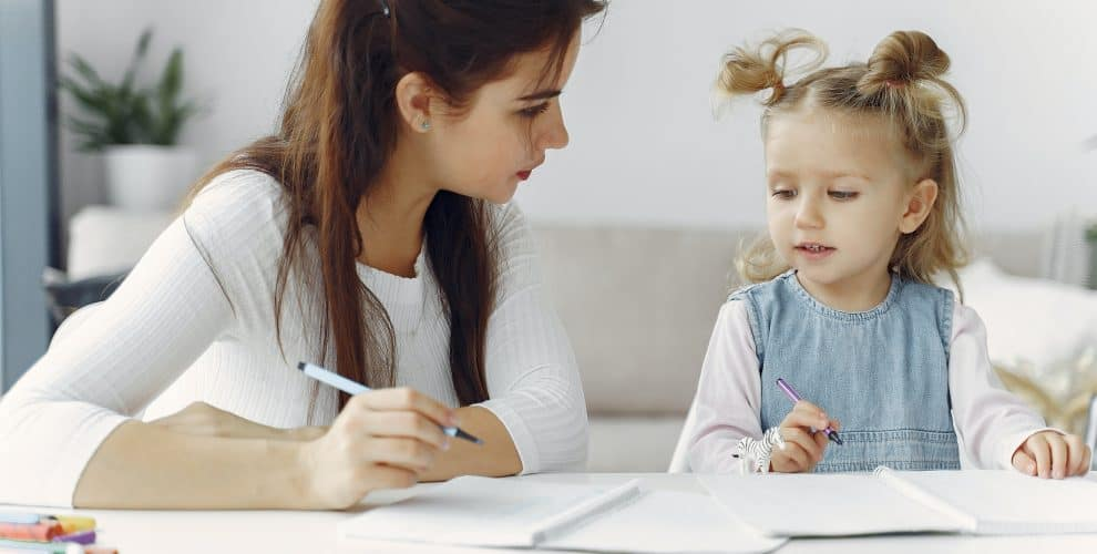 Woman Teaching Little Kid How To Draw 3985026